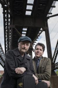 Billy Bragg and Joe Henry elevated train tracks backdrop photo